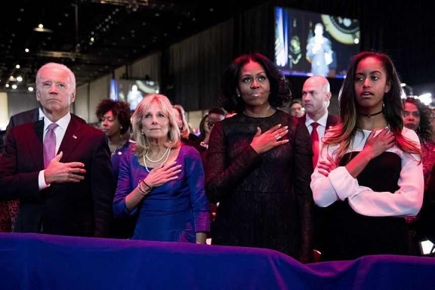 (From left) US Vice-President Joe Biden, Jill Biden, first lady Michelle Obama and Malia Obama stand for the national anthem before President Barack Obama arrives on stage to deliver his farewell address at McCormick Place in Chicago on Jan 10, 2017.