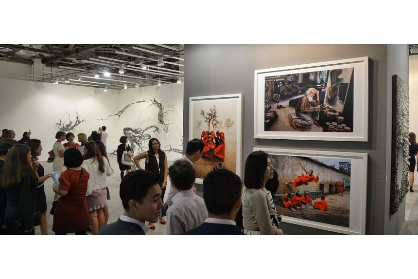 Visitors at the Art Stage Singapore held at the Marina Bay Sands Expo and Convention Centre on Jan 20, 2016. Art Stage Singapore is set to return for its seventh edition this year.