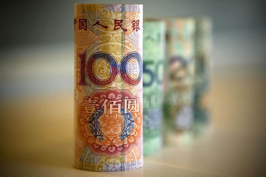 Chinese Renminbi bank notes are displayed for a photograph in Beijing, China.
