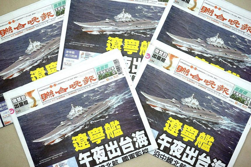 Copies of the 'United Evening News', an afternoon paper with a front page report on China's aircraft carrier Liaoning that passed through the Taiwan Strait, in Taipei, Taiwan on Jan 11, 2017.