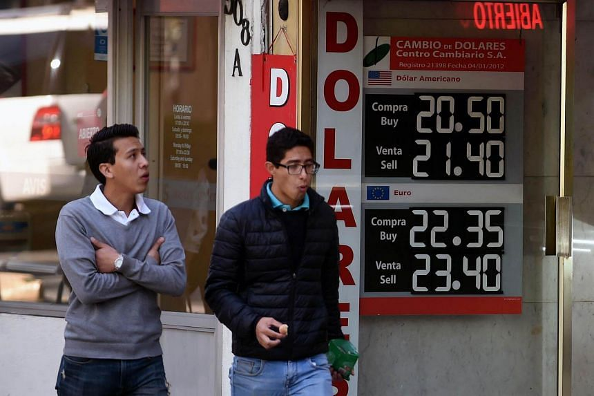 A currency board shows the US dollar exchange rate at a bureau de change in Mexico City on Jan 11, 2017.