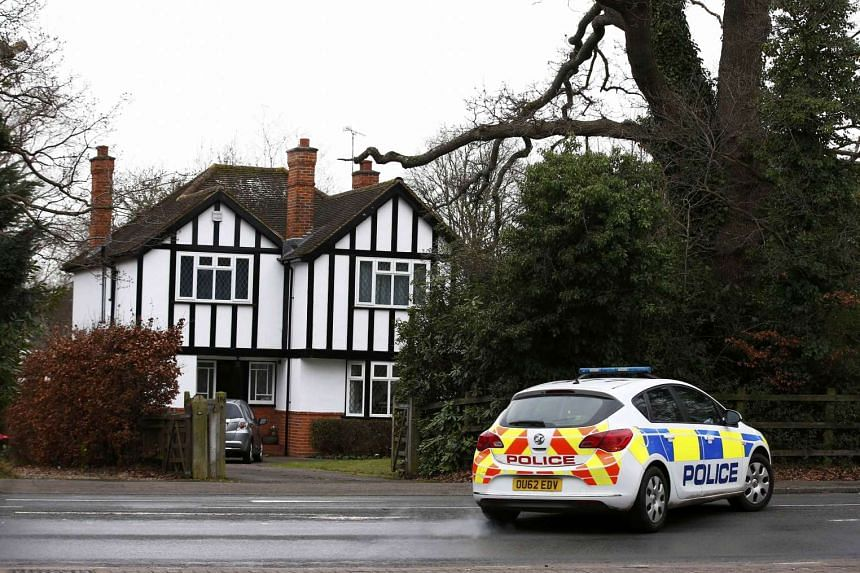 A police car drives past an address which has been linked by local media to former British intelligence officer Christopher Steele in Wokingham, Britain on Jan 12, 2016.