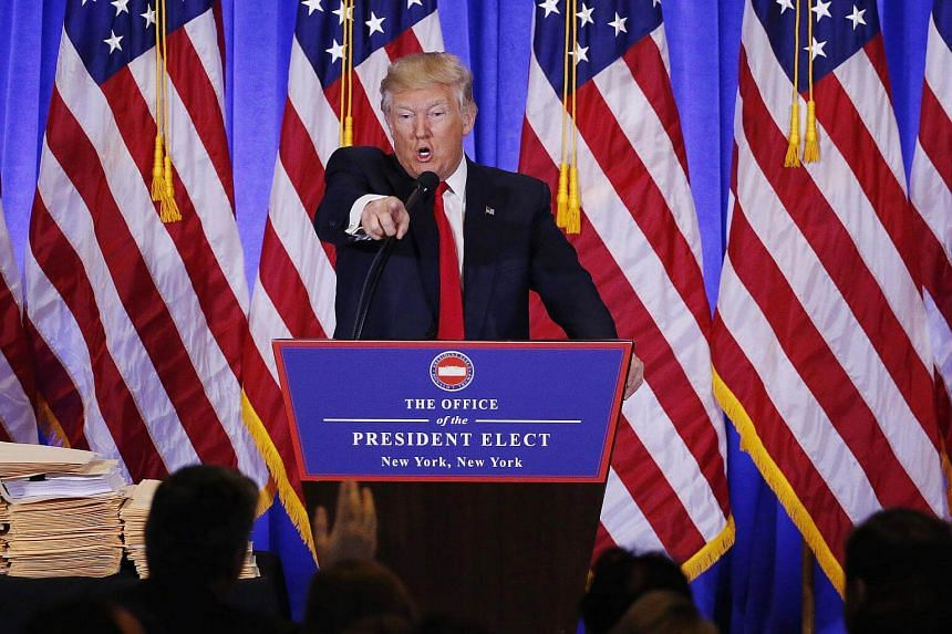 President-elect Donald Trump argues with CNN's Jim Acosta during a news conference in the lobby of Trump Tower in Manhattan, New York City on Jan 11, 2017.
