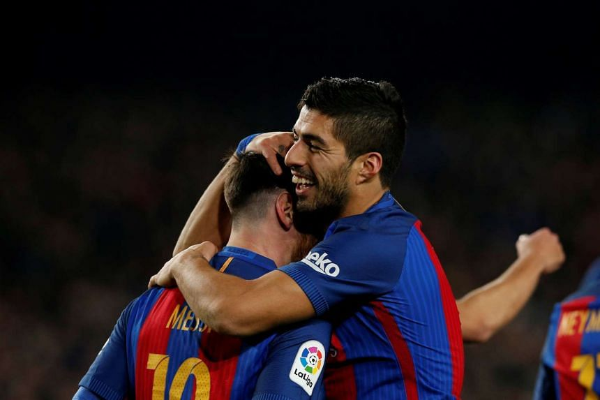 Barcelona striker Luis Suarez (right) has called for the team to give teammate Lionel Messi a new contract without further ado.