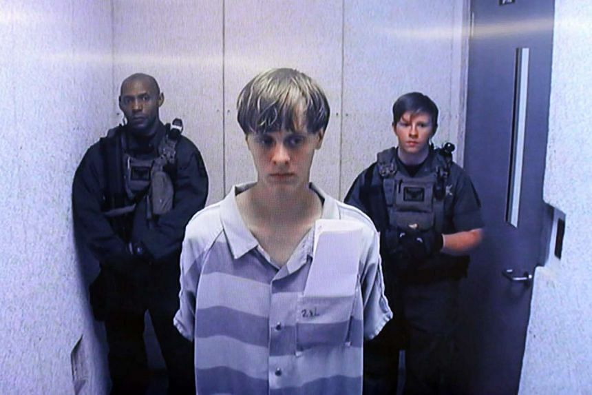 A file picture from 2015 shows Dylann Roof (centre) appearing via video link at a bond hearing.