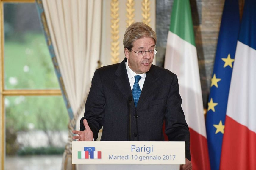Italy's Prime Minister Paolo Gentiloni gives a statement following a meeting with French President on Jan 10, 2017 at the Elysee Palace in Paris.