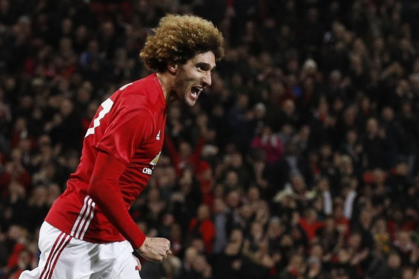 Manchester United have triggered a clause in Marouane Fellaini's contract that will keep the midfielder at Old Trafford until 2018, according to the club's website.