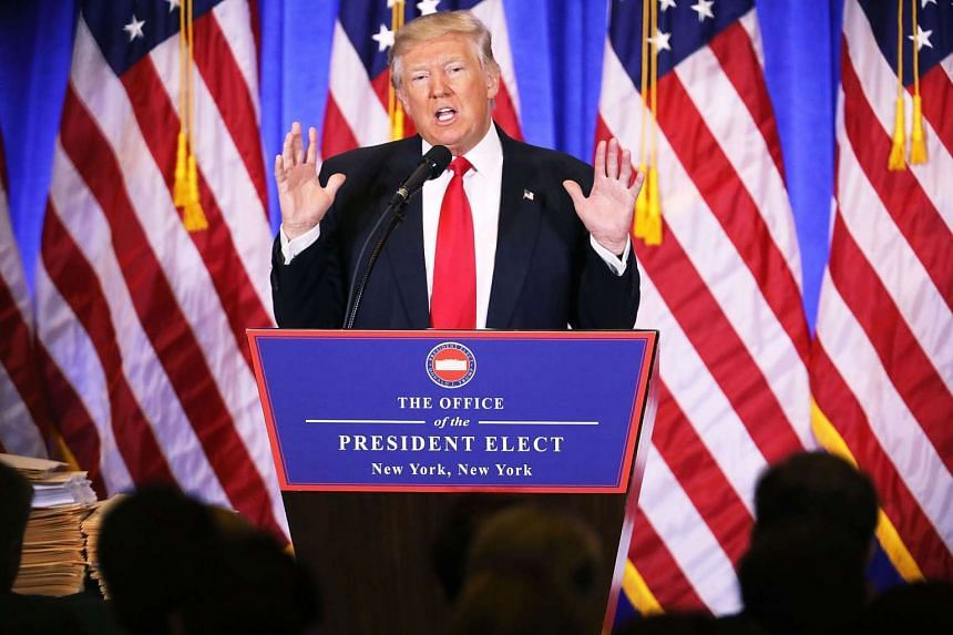 US President-elect Donald Trump speaking at a news cenference at Trump Tower on Jan 11, 2017, in New York City. This is Trump's first official news conference since the November elections.