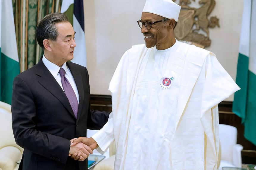 Nigeria's President Muhammadu Buhari greets China's Foreign Minister Wang Yi during his visit to the Presidential Villa in Abuja, Nigeria on Jan 11, 2017.