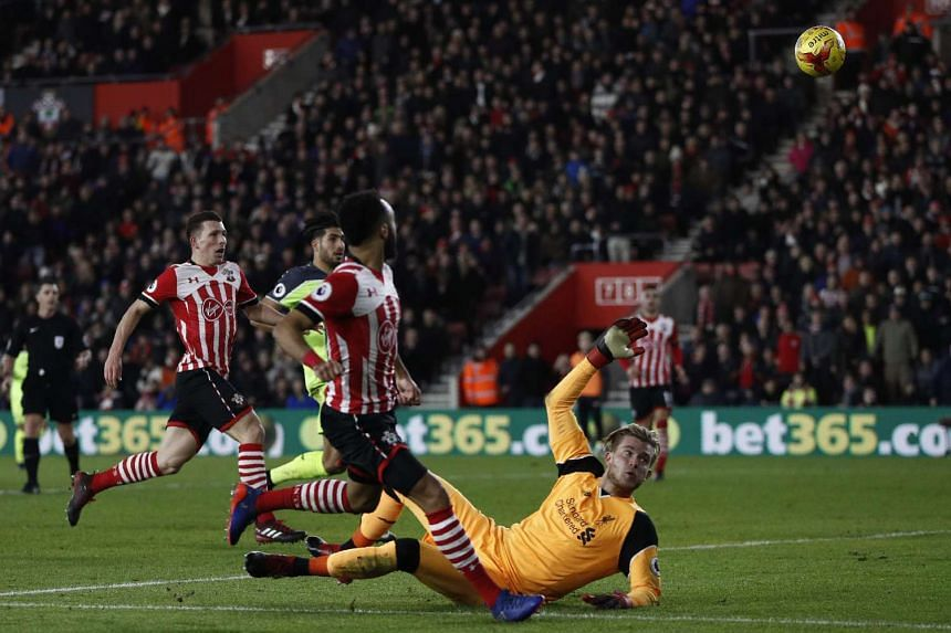 Southampton's English midfielder Nathan Redmond (centre) watches the ball after chipping it over Liverpool's German goalkeeper Loris Karius at St Mary's Stadium in Southampton, southern England on Jan 11, 2017.