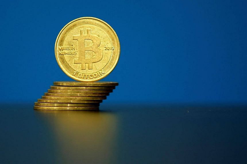 Bitcoin (virtual currency) coins are seen in an illustration picture taken at La Maison du Bitcoin in Paris, France.