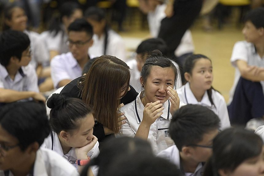 Serangoon Garden Secondary School student Sheryl Lim sheds tears of joy after being congratulated by her teacher. She had been anxious about her results, and said that she was happy with her scores.