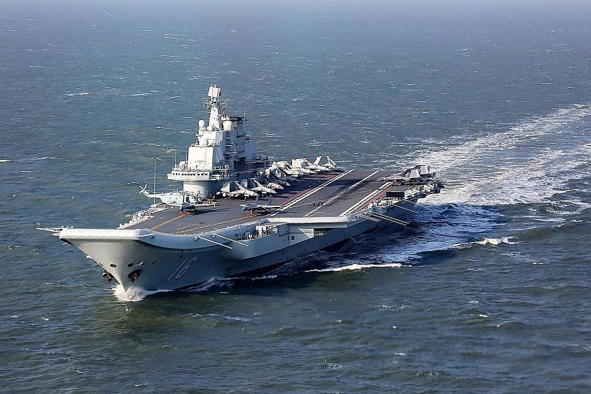 """Yesterday was the first time that the Chinese aircraft carrier Liaoning had sailed through the Taiwan Strait. Analysts say it is China's way of putting pressure on Taiwan to acknowledge the """"one China"""" principle."""