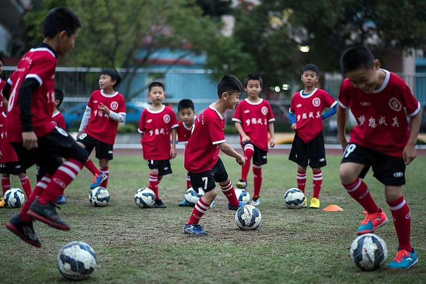 Children training in Guangzhou. China is hoping to produce a generation of top footballers by building thousands of academies.