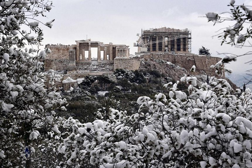 The Acropolis on Tuesday after a rare heavy snowfall in Athens. Some refugees in Greece have been moved to heated tents.