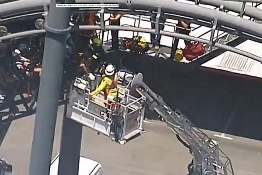 Rescue workers evacuating passengers trapped in their seats 20m off the ground, some for 90 minutes, when the Arkham Asylum ride at Movie World malfunctioned. None of the passengers, mostly teenagers, needed medical treatment. The theme park said the