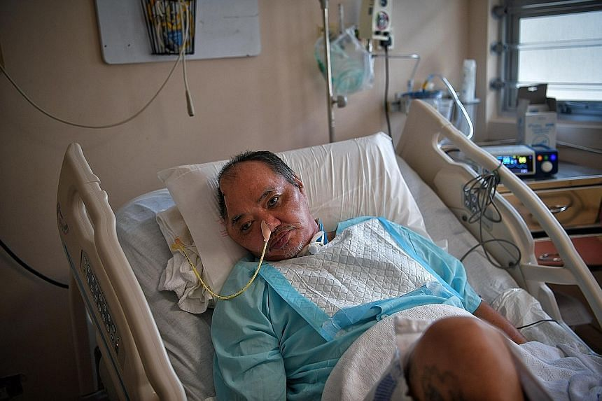 Retiree Lim Chwee Leong in his bed at Tan Tock Seng Hospital. After his accident last November, Mr Lim underwent a tracheostomy and two operations to his brain. Although he has not fully recovered, he told his girlfriend that he could remember his fa