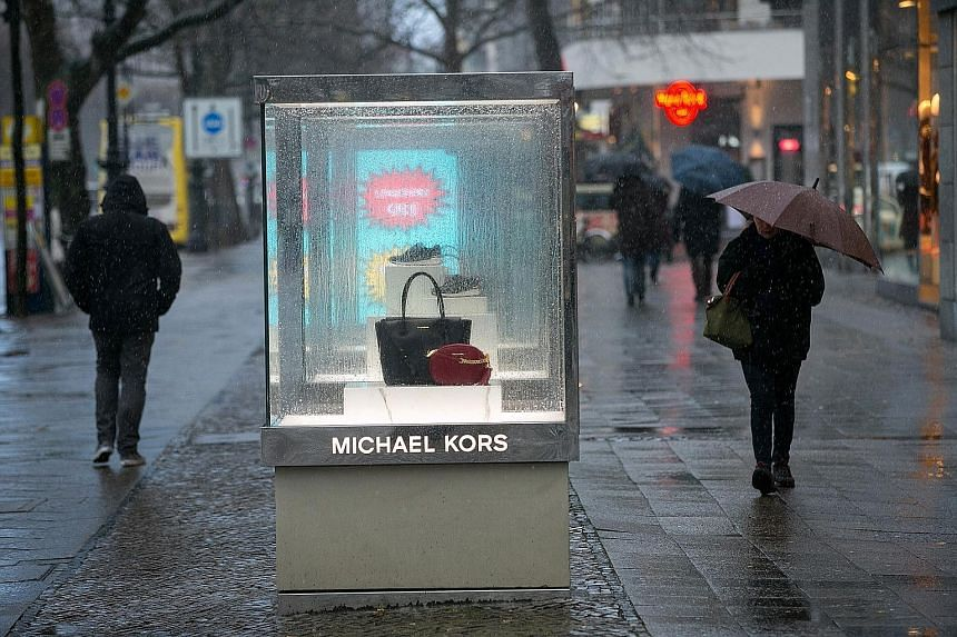 Michael Kors handbags in a display case in Berlin, Germany. The number of new handbag styles the brand introduced In the final three months of last year dropped by 24 per cent from the preceding quarter.