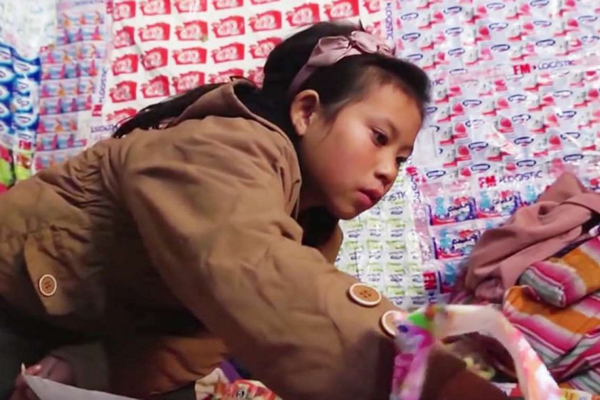A girl in a Chinese town that processes imported plastic waste in the documentary Plastic China (above), which is part of the Sundance Film Festival.
