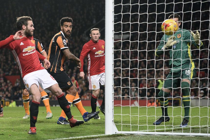 Manchester United midfielder Juan Mata (left) taps in the opener during the first leg of the League Cup semi-final against Hull City in the 56th minute.