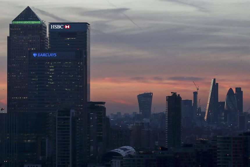 Canary Wharf and the city are seen at sunset in London, on Dec 14, 2016.