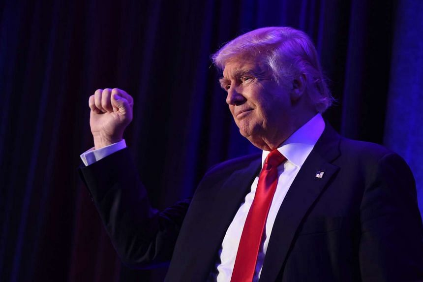 US President-elect Donald Trump concurred with intelligence agencies that the Russian government hacked into Democratic Party e-mail accounts in an apparent attempt to influence the outcome of the election.