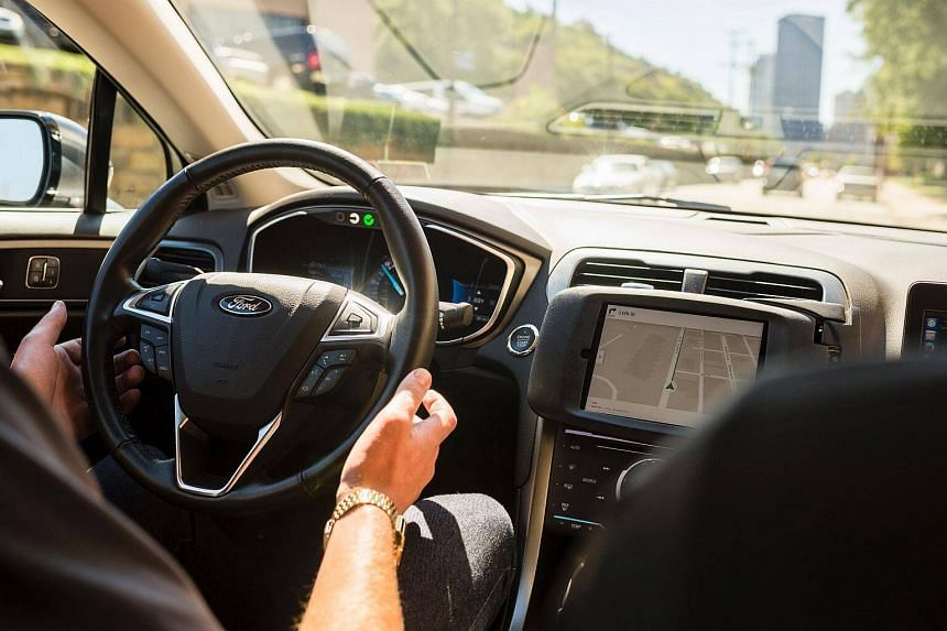 A driver looking from an Uber self-driving car on Sept 13, 2016 in Pittsburgh, Pennsylvania.