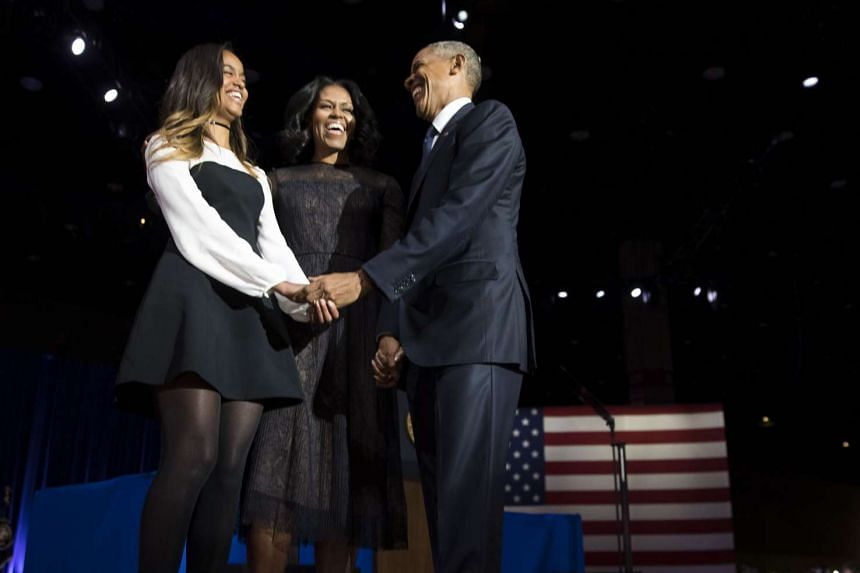 Malia Obama (left) with her parents at US President Barack Obama's farewell address in Chicago on Jan 10, 2017.