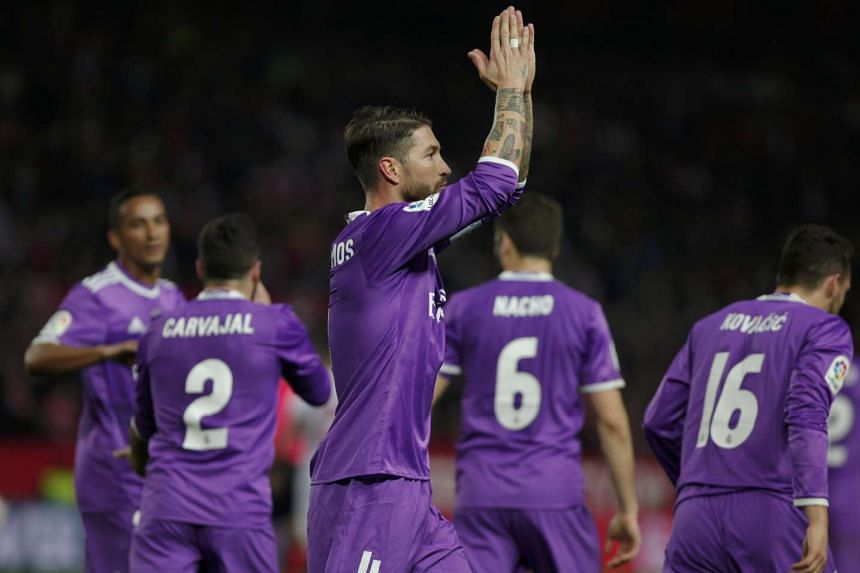 Real Madrid's Sergio Ramos celebrates after scoring his first goal during their match against Sevilla on Jan 12, 2017.