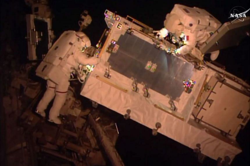 US astronaut Commander Shane Kimbrough (left) and Flight Engineer Thomas Pesquet of ESA performing the second of two spacewalks in order to implement an upgrade to the space station's power management on Jan 13, 2017.