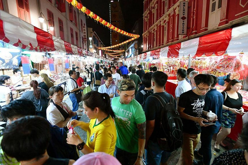 Shoppers at the Festive Street Bazaar and Carnival in Chinatown, on Jan 7, 2017.