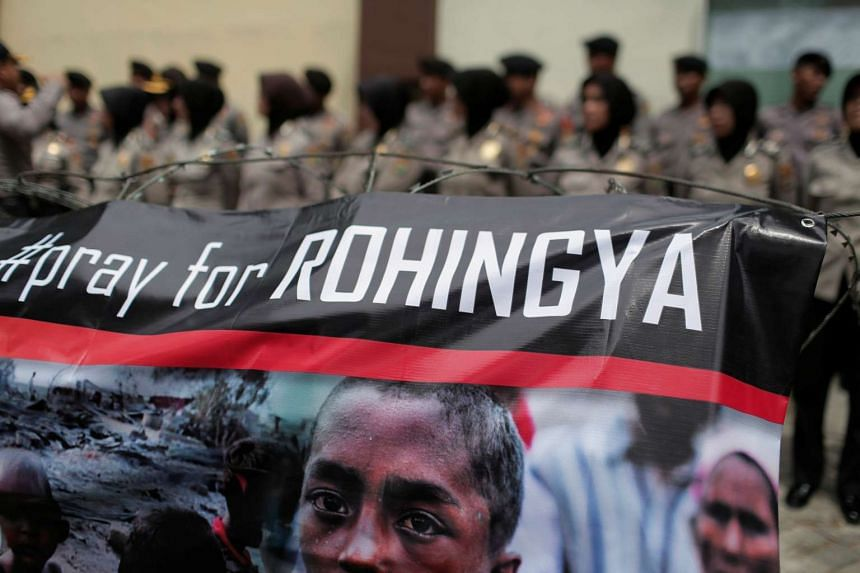 File photo of a banner held by demonstrators during a protest against what they say is the crackdown on ethnic Rohingya Muslims in Myanmar.