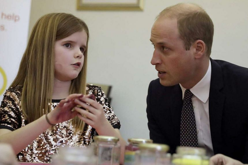 Prince William talks to a child during his visit to a Child Bereavement UK centre.