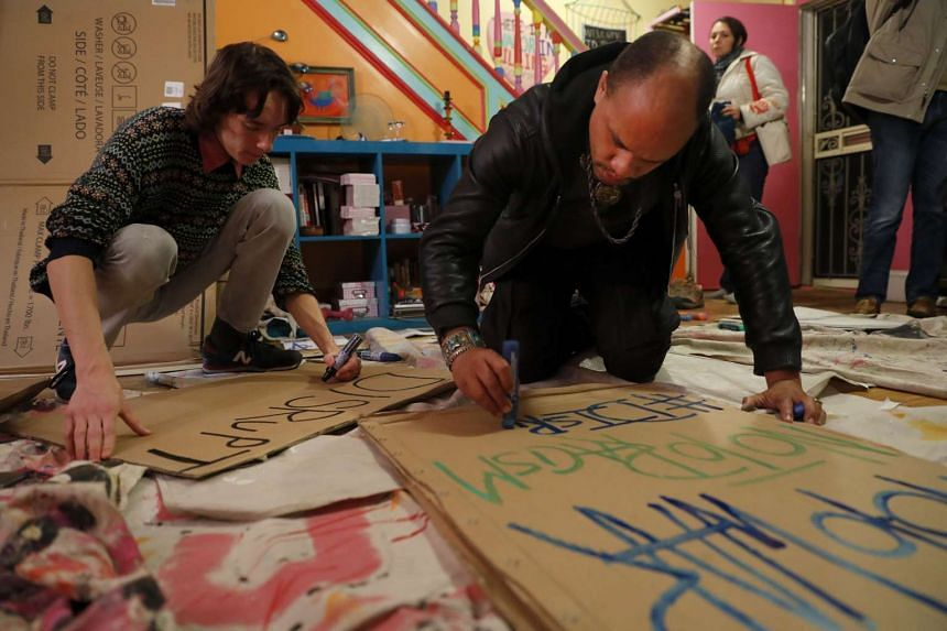 Activists, including David Thurston (right), gather to make signs for demonstrations against the upcoming inauguration of Donald Trump on Jan 11, 2017 in Washington, DC.