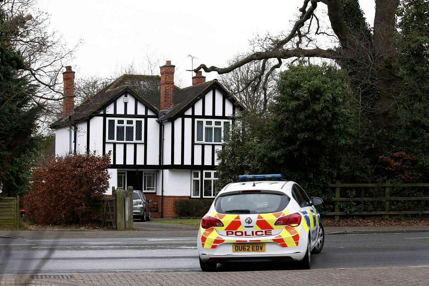 A police car drives past an address which has been linked by local media to former British intelligence officer Christopher Steele, who has been named as the author of an intelligence dossier on President-elect Donald Trump, in Wokingham, Britain, on