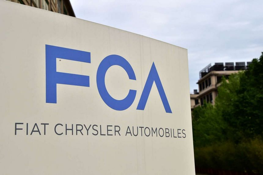 This file photo taken on April 19, 2015 shows the Fiat Chrysler Automobiles logo at the entrance of the headquarters in Turin.
