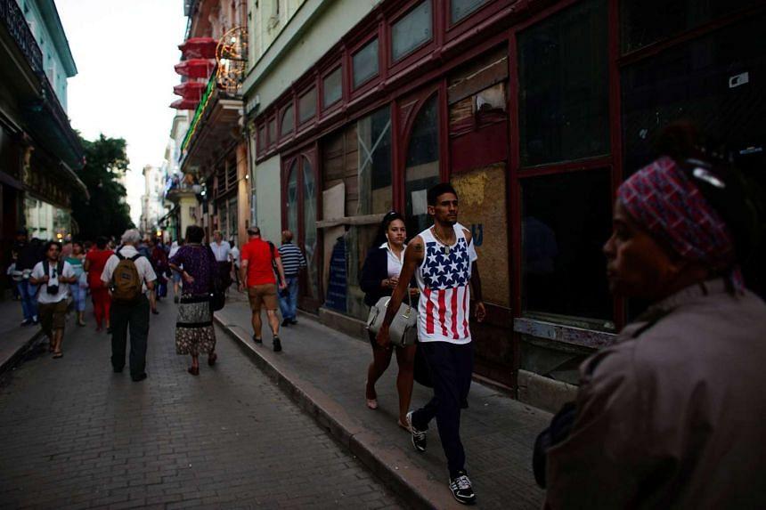 A man wearing the United States' colours walking on a street in downtown Havana, Cuba, on Jan 12, 2017.