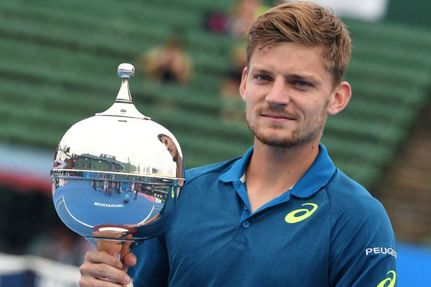 David Goffin holds the trophy after winning the men's final against Ivo Karlovic at the Kooyong Classic tennis tournament in Melbourne on Jan 13, 2017.