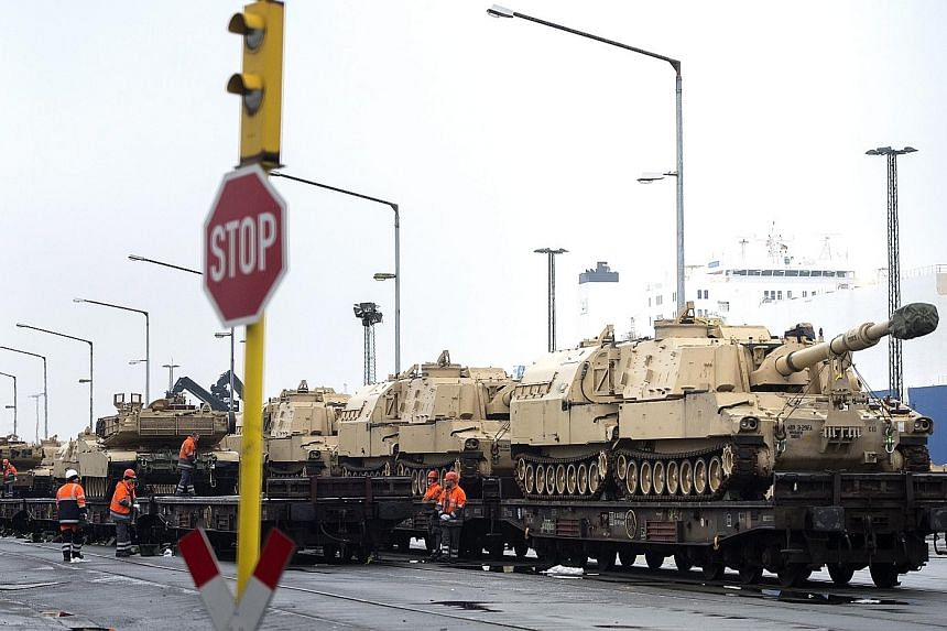 US military vehicles being prepared for railway transport in Bremerhaven, northern Germany, last Saturday. A contingent of US troops entered Poland at the Olszyna border crossing with Germany yesterday, with heavy equipment to follow.