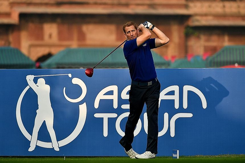 Josh Burack teeing off before the Panasonic Open India at the Delhi Golf Club in New Delhi last month. Appointed Asian Tour CEO last October, he does not see the US PGA Tour as a threat to the region as it already has a very packed schedule.