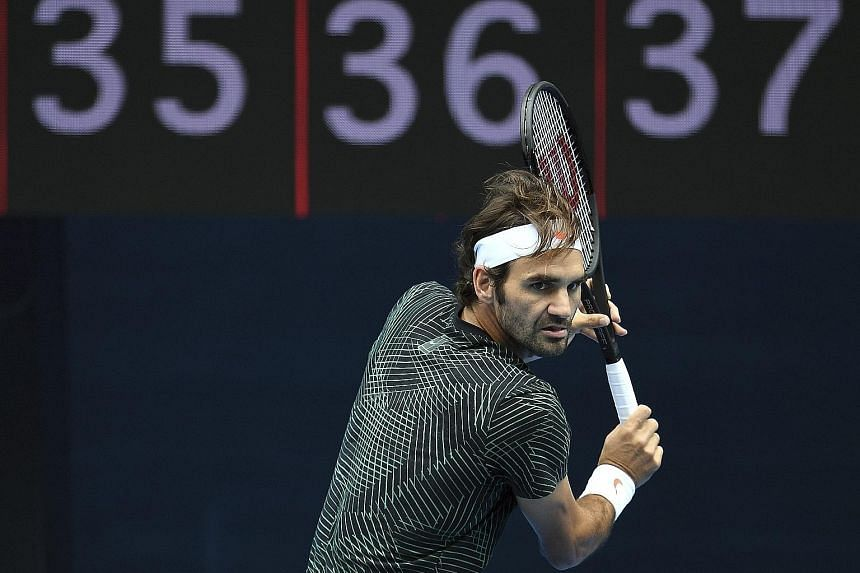 Swiss tennis legend and 17-time Grand Slam champion Roger Federer practising for the Australian Open on Rod Laver Arena in Melbourne on Monday. Most higher-ranked players will be hoping to avoid an early clash with him or fellow former world No. 1 Ra