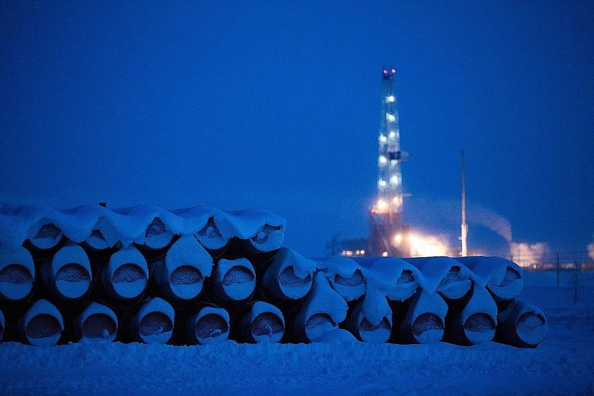 Pipelines on the Russkoye oil field in Russia, operated by Rosneft PJSC. Qatar's US$11 billion (S$15.7 billion) Rosneft deal builds on the country's growing Russian portfolio. It has agreed to buy 24.9 per cent of the airport in St Petersburg and com