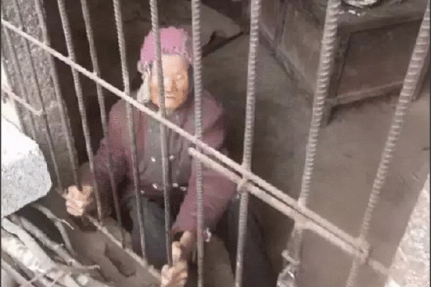 """The 92-year-old woman, surnamed Yang, has been living in a pigsty """"for years"""" in the southern Guangxi region of China, according to reports."""