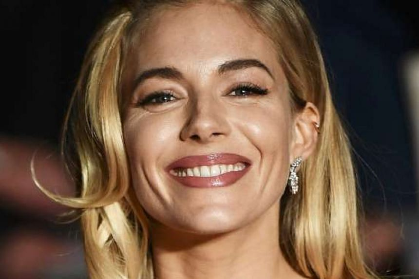 Actress Sienna Miller said she was in fact weeping with laughter after filming with Ben Affleck for their new gangster movie Live By Night.