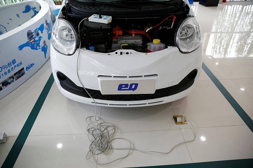 A Chery EQ electric car is displayed at a electric car dealership in Shanghai, China, on Jan 11, 2017.
