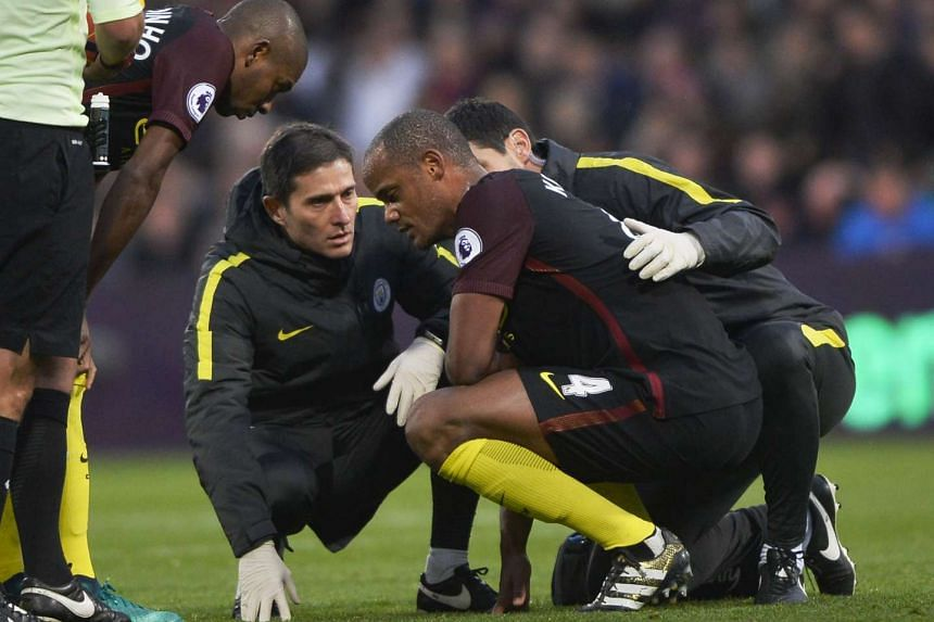 Manchester City's Vincent Kompany goes down with an injury on Nov 19, 2016.