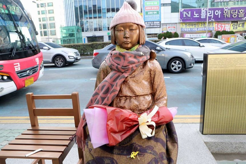 The statue of a girl, in memory of women forced to work in Japanese brothels in World War II, in front of the Japanese Consulate in Busan, South Korea, on Jan 7, 2017.