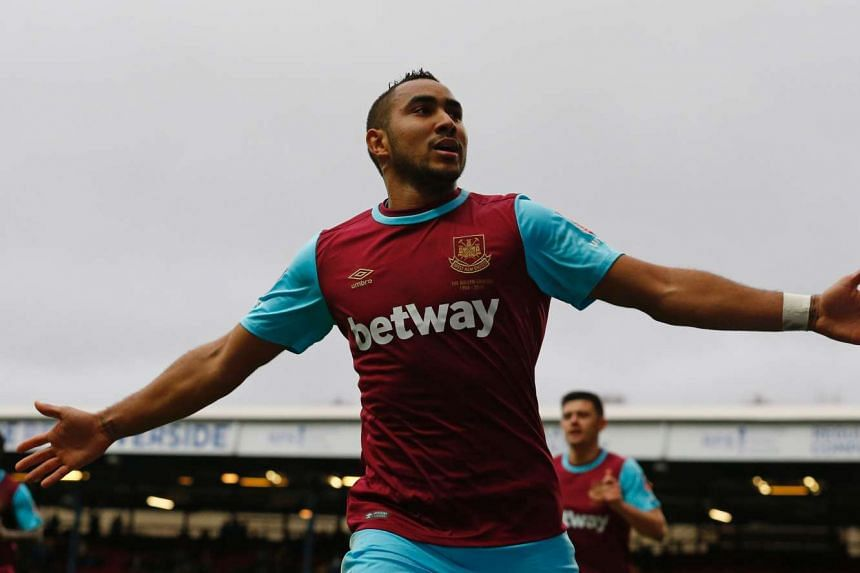 West Ham United's French midfielder Dimitri Payet celebrating a goal.