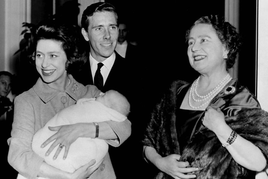A 1961 photo shows Princess Margaret (left), holding her son Linley, with husband Lord Snowdon and Britain's Queen Mother.