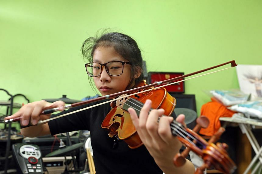 Despite hearing loss and a rare heart defect, 13-year-old Anastasia Mary Chieng has learnt to play the electone, drums and the violin and now performs at public events.